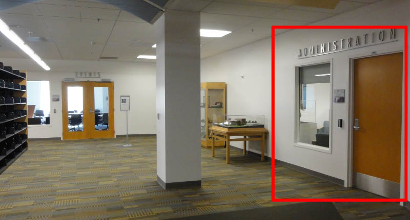 Photo of part of the 4th floor showing the entrance the the Library Administration